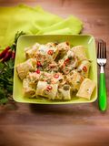 Paccheri  carrot capers and hot chili pepper. Selective focus Stock Photo