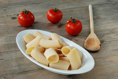 Paccheri - italian pasta. Paccheri,italian pasta and tomato Royalty Free Stock Photography