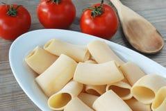 Paccheri - italian pasta. Paccheri,italian pasta and tomato Royalty Free Stock Photo