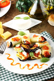 Paccheri pasta with eggplant, ricotta cheese and tomato Royalty Free Stock Photos