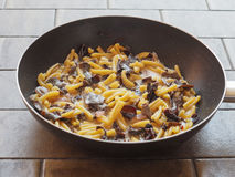 Paccheri pasta with mushrooms Royalty Free Stock Images