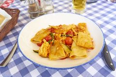 Paccheri Pasta With Zucchini Red Cherry Tomatoe and Riccota Chee royalty free stock image
