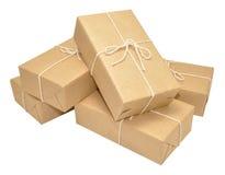 Pacchetti coperti della carta di Brown legati con corda Fotografia Stock