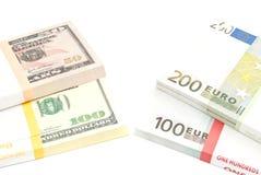 Pacchetti degli euro e dei dollari Fotografia Stock