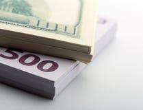 Pacchetti dei dollari e degli euro Fotografia Stock Libera da Diritti