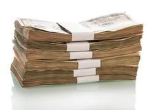 Pacchetti del primo piano dei dollari isolati su bianco Fotografia Stock Libera da Diritti