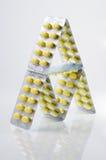Pacchetti della pillola della piramide fotografia stock