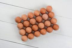24 pacchetti delle uova di Brown Fotografia Stock