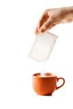 Pacchetto con una medicina e una tazza Fotografia Stock