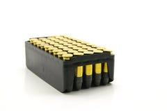 Pacchetto delle munizioni vuote dorate del punto nel calibro 222 Fotografie Stock