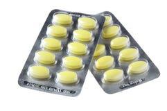 Pacchetto delle pillole gialle immagine stock