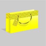 Pacchetto di carta di colore giallo Fotografia Stock