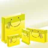 Pacchetto di carta quattro di colore giallo Immagine Stock