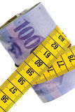 Pacchetto di economia di simbolo con i franchi svizzeri e nastro adesivo Fotografie Stock Libere da Diritti