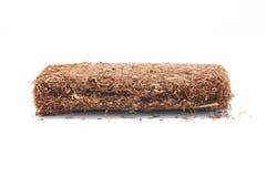 Pacchetto isolato tabacco di rotolamento della mano fotografia stock libera da diritti