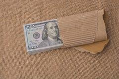 Pacco della banconota del dollaro americano avvolto in carta Fotografia Stock Libera da Diritti