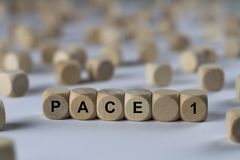 Pace 1 - cube with letters, sign with wooden cubes Stock Image