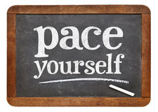 Pace yourself advice - blackboard sign Stock Photography