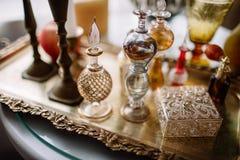 Pachnidło butelki na stole Obrazy Royalty Free