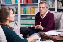 Paciente do psiquiatra e da mulher fotografia de stock royalty free