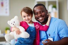 Paciente e doutor pequenos Foto de Stock