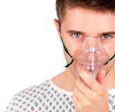 Paciente joven con la máscara Foto de archivo libre de regalías