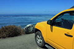 Into the pacific. Car parked to view the pacific at the pacific coast highway Royalty Free Stock Photography