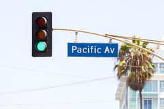 Pacific avenue street sign and traffic lights. Royalty Free Stock Photos
