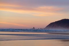 Pacific beach at sunset royalty free stock photo