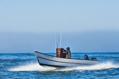 Dory Boat Coming In At Cape Kiwanda Royalty Free Stock Photo