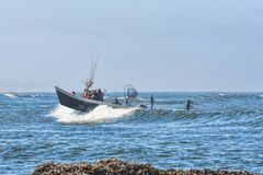 Dory boat and paddle boards at Pacific City Stock Photography
