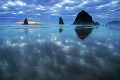 Pacific Coast. Evening at the Pacific Coast - sand, rocks, reflections Royalty Free Stock Image