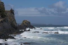 Pacific Coast of Alaska. Pacific Ocean crashing into bluffs along the coast of Alaska Royalty Free Stock Photography
