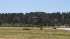 Pacific coast dream machines;helicopter landing stock video