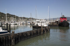 Pacific coast harbor landscape marina with fishing boats Royalty Free Stock Photo