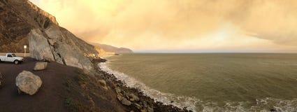 Pacific Coast Highway on Fire, Point Mugu. Brush fire plump smoke above PCH-1 near La Jolla Canyon, Ventura County, CA Royalty Free Stock Photography