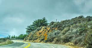 Pacific Coast Highway on a foggy day. California royalty free stock photography