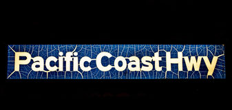 Pacific coast highway sign. On black background Royalty Free Stock Photography
