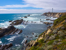 Pacific Coast, Lighthouse. Pacific Coast, rocks and waves, lighthouse, California Royalty Free Stock Images