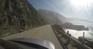 Pacific coast road from the perspective of a car stock video footage
