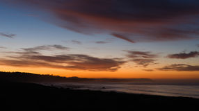 Pacific Coast Sunrise Dramatic Saturated Orange Hues Over Ocean Royalty Free Stock Images