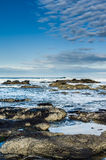 Pacific coast tide pool with clouds Stock Photography