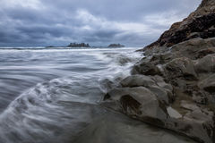 Pacific Coast in Tofino. View on the Pacific Ocean Coast during a cloudy winter sunset. Picture taken in Chesterman Beach, Tofino, BC, Canada stock photo