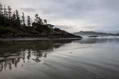 Pacific Coast in Tofino. View on the Pacific Ocean Coast during a cloudy winter sunset. Picture taken in Chesterman Beach, Tofino, BC, Canada royalty free stock photos