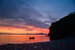 Pacific dawn. Dawn in an unnamed bay and the fishing boat Royalty Free Stock Photography