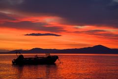 Pacific dawn. Dawn in an unnamed bay and the fishing boat Stock Images