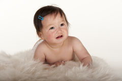 Pacific Islander baby girl learning to crawl Stock Image