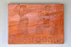 Pacific Islander male and female restrooms sign. Pacific Islander male and female figures restrooms sign in Rarotonga, Cook Islands stock photography