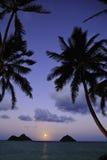 Pacific moonrise in hawaii. Pacific moonrise between the mokulua islands in oahu, hawaii stock image