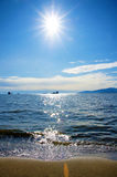 Pacific Northwest ocean beach near Vancouver English Bay with su. N at noon midpoint Stock Image